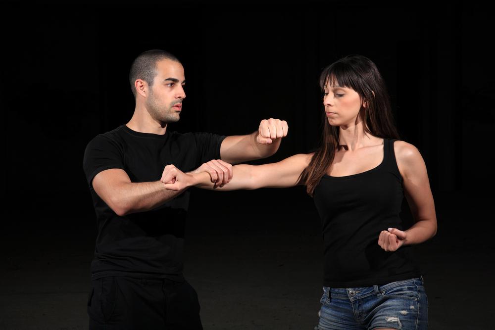 instructor teaching self defense